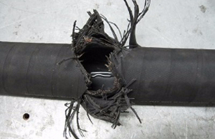 Torn hydraulic cable